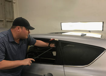 Littleton Colorado paintless dent repair services and auto hail removal.